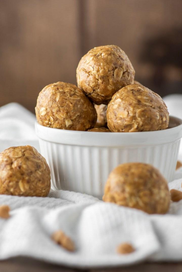 peanut butter energy balls stacked in white ramekin
