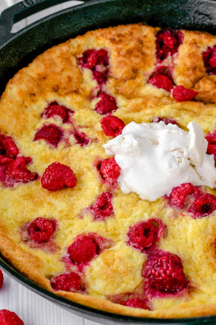 close-up of raspberry lemon dutch baby in skillet