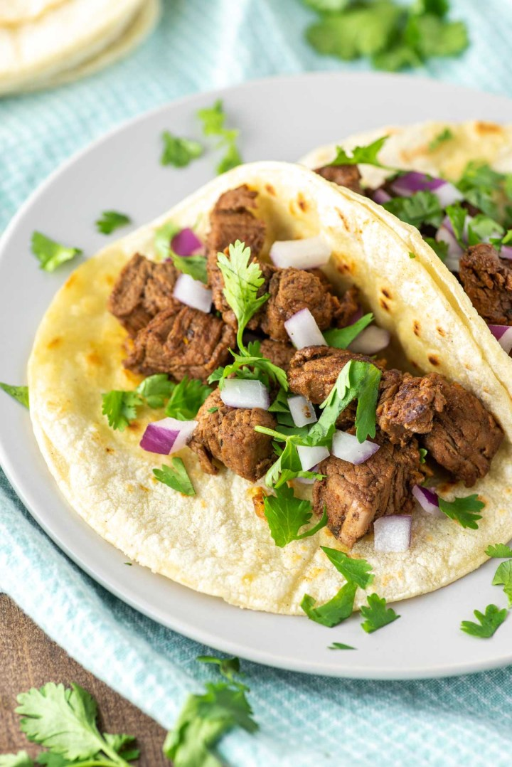 two carne asada tacos on plate