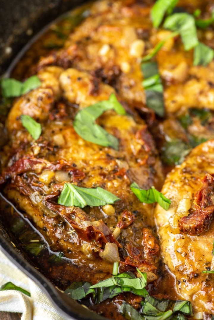 sun-dried tomato chicken in cast iron skillet