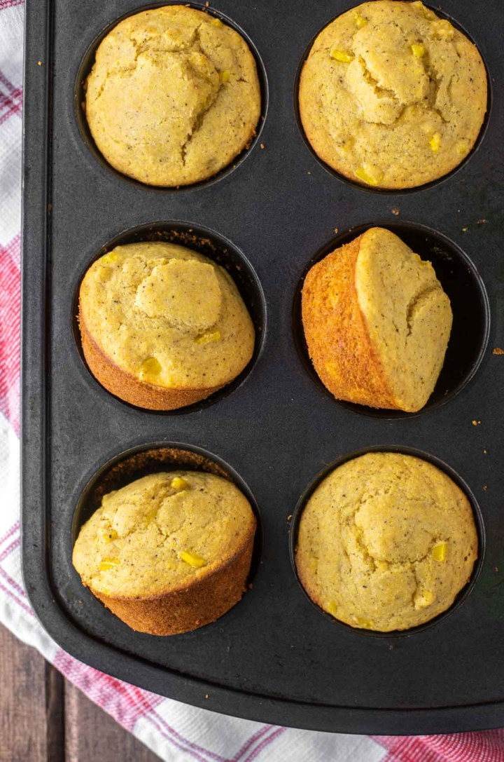 overhead shot of cornbread muffins in tin