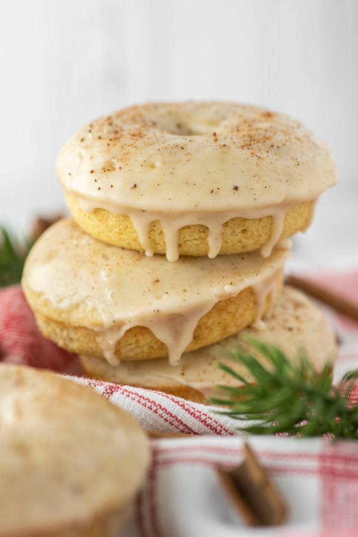 three eggnog donuts stacked