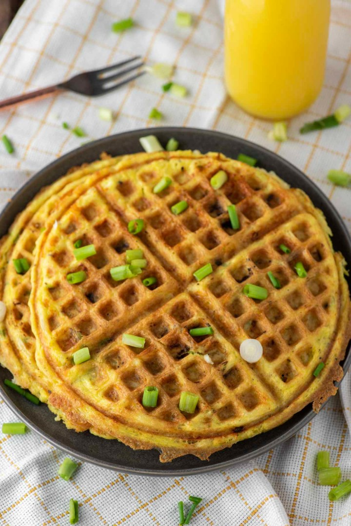 egg and cheese hash brown waffles on plate