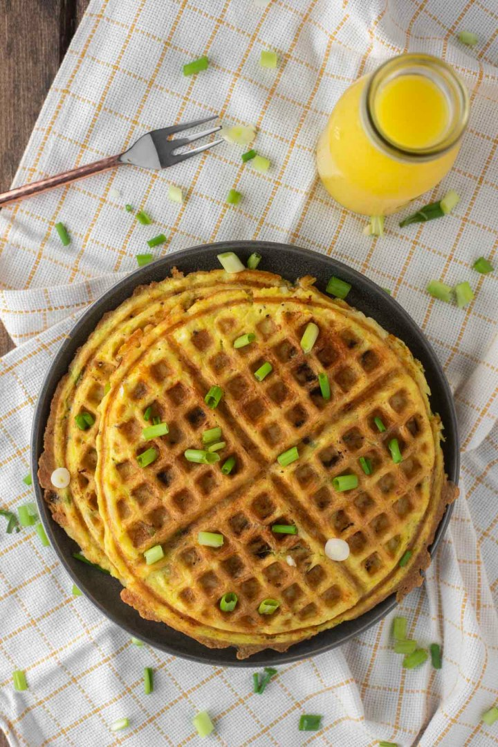 overhead shot of hash brown waffles on plate