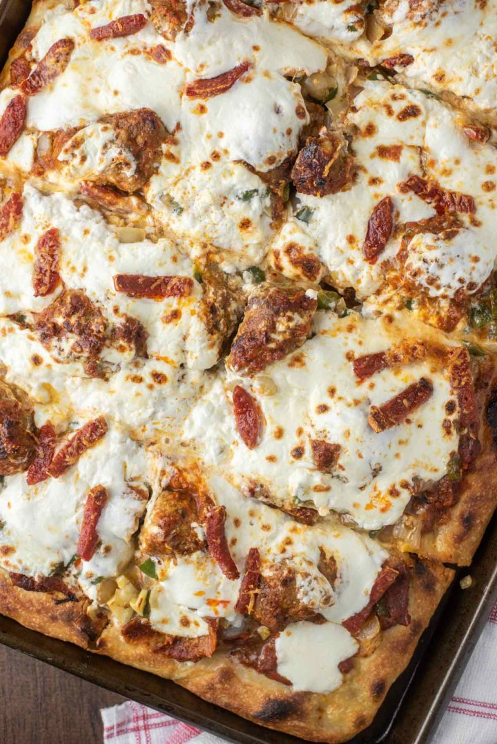 overhead shot of Sicilian-style pizza in sheet pan