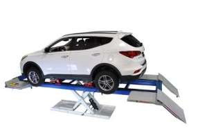Car Alignment System: Vehicle in Clamps