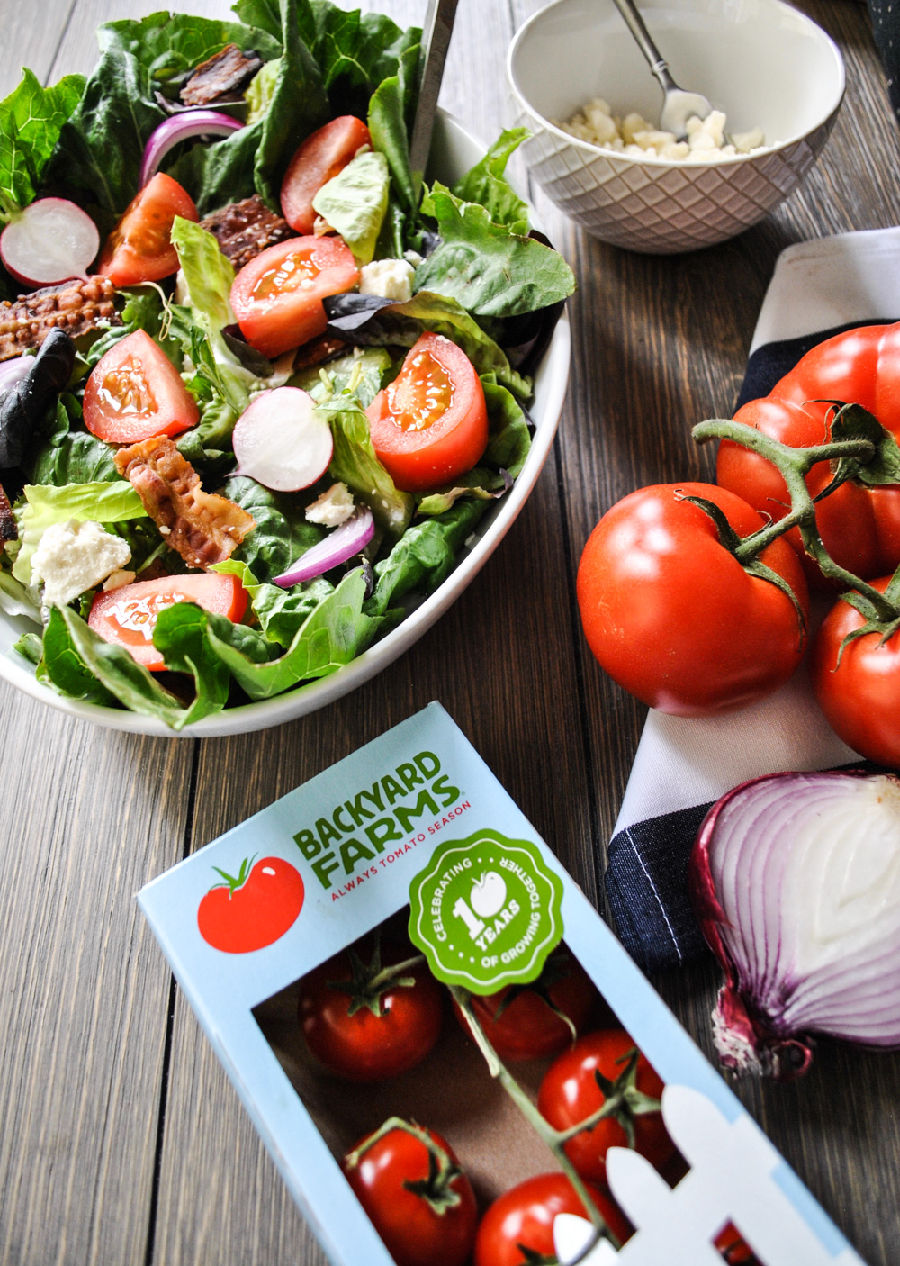 Lifestyle Blogger Jenny Meassick of Chocolate and Lace shares her recipe for BLT salad featuring Backyard Farms tomatoes.