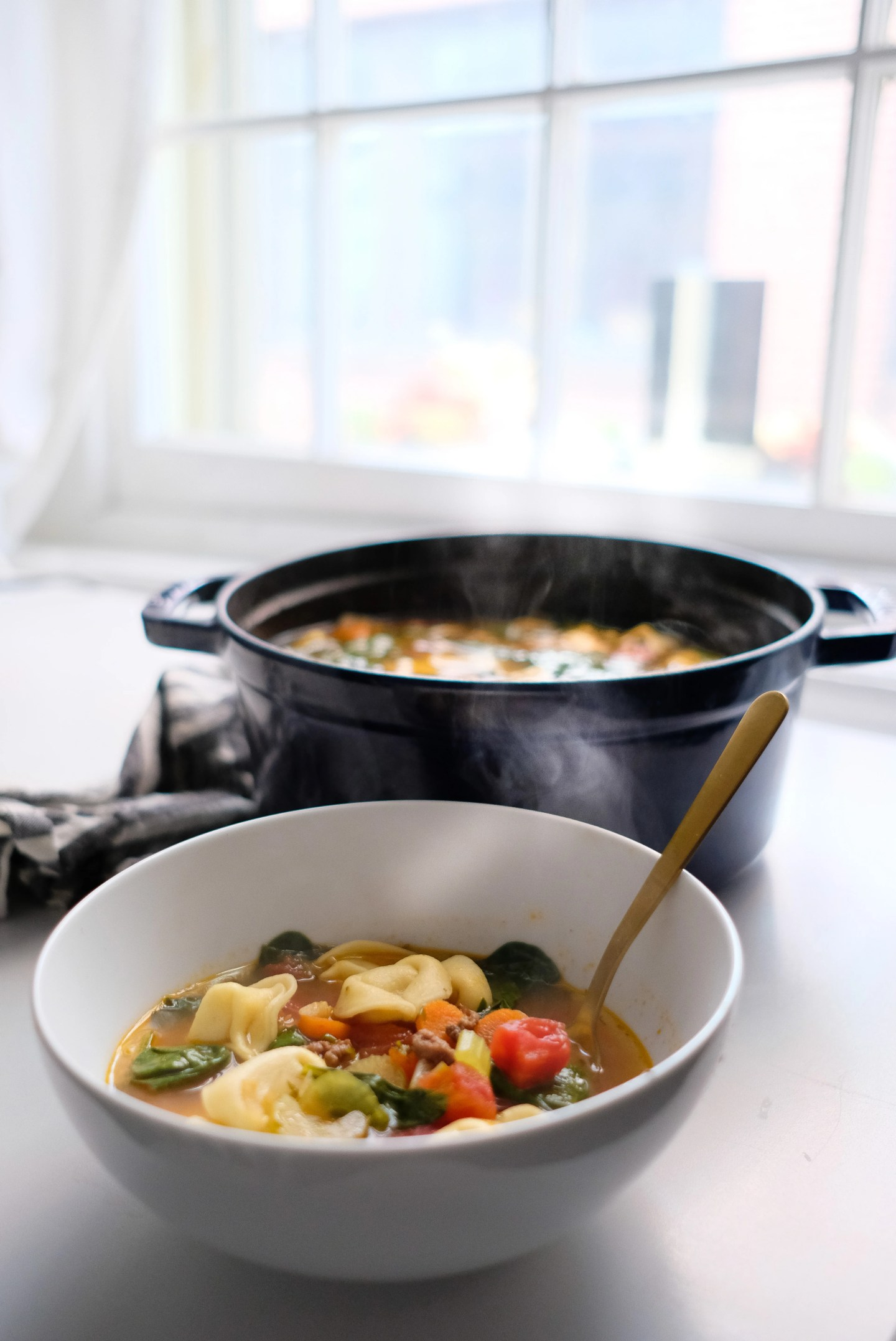 Lifestyle blogger Chocolate & Lace shares a delicious recipe for hearty Tortellini and Arugula Soup.