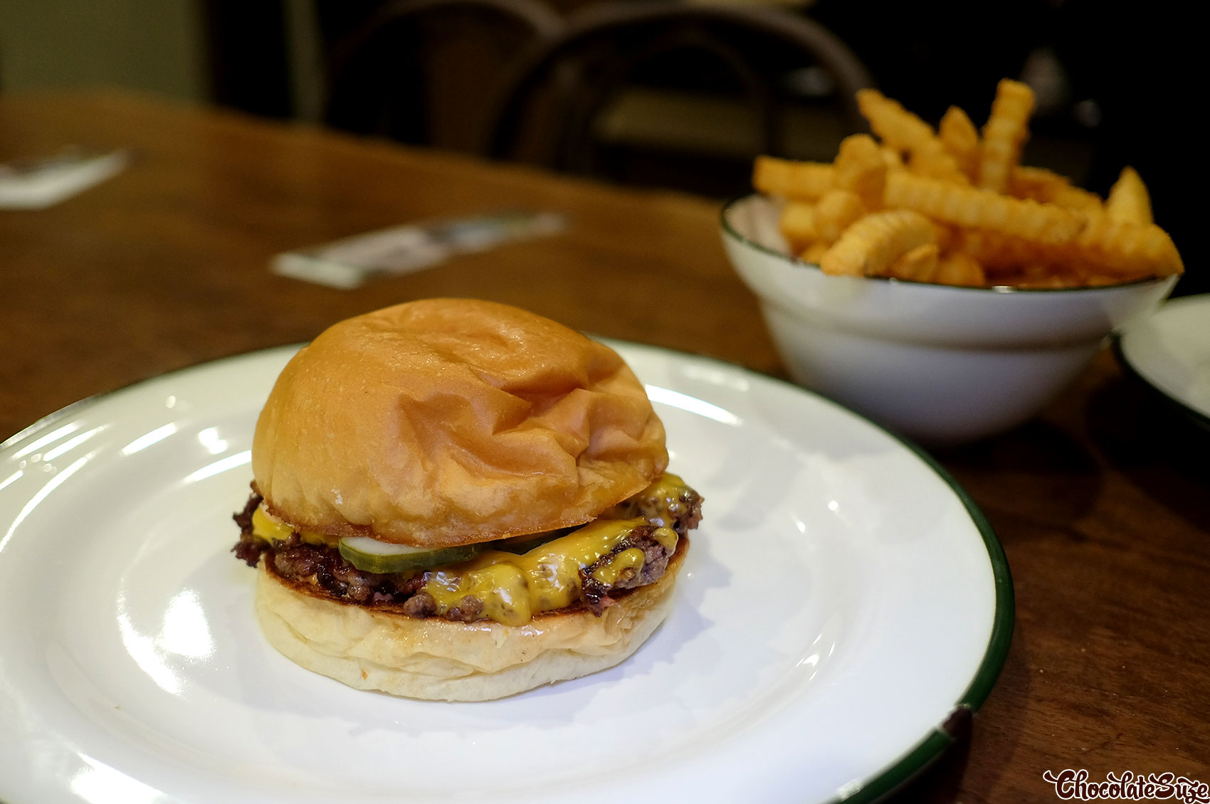 Cheeseburger and crinkle cut chips at Bush, Redfern