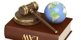 Law book, gavel and globe