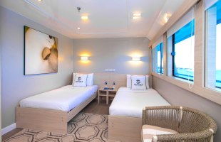 Cabin with single beds on Odyssey Yacht