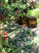 A fountain under a shady tree exuces tranquility