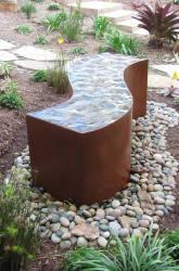 cor-ten steel water feature in modernistic landscape design