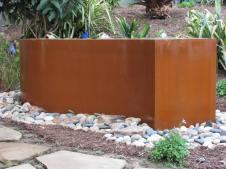 cor-ten steel fountain left to rust naturally