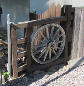 A wagon wheel makes a decorative fence element