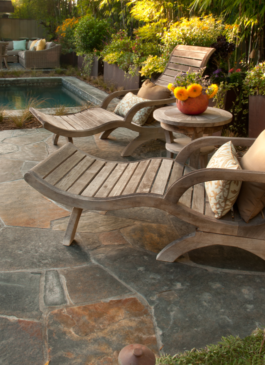 Despite of the many built elements the hardscapes do not overpower the garden and plants are allowed to soften all.