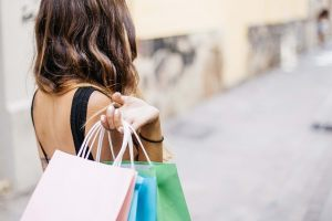 A woman with shopping bags.