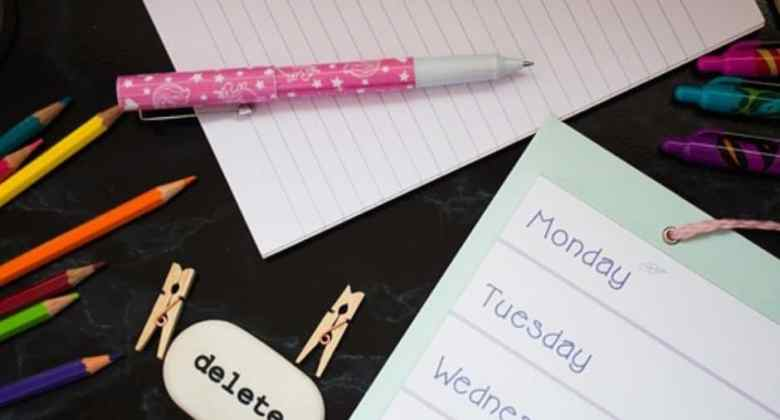 Journal and planner supplies with black background