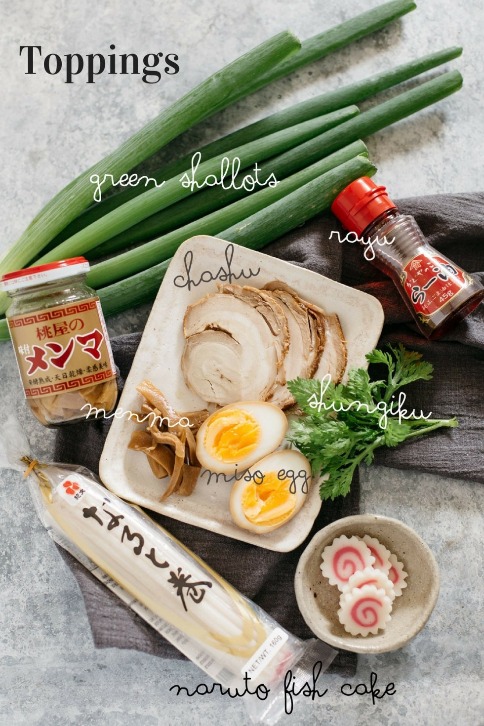 various shio ramen toppings such as chashu and miso eggs