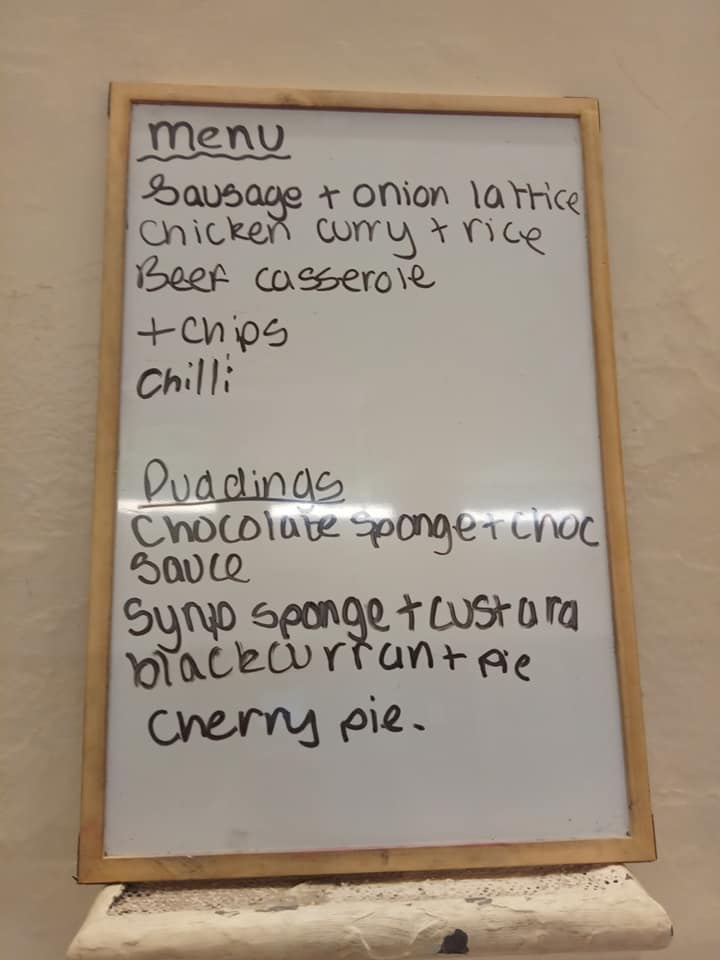 A whiteboard with the Open Kitchen menu