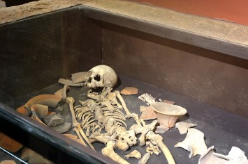 Skeleton with ceremonial burial pottery