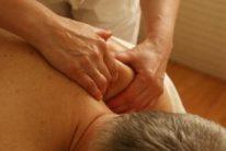 men getting his shoulder massaged