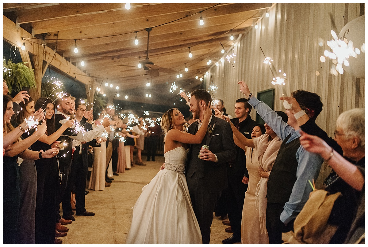 A sparkler exit during a beautiful fall farm wedding