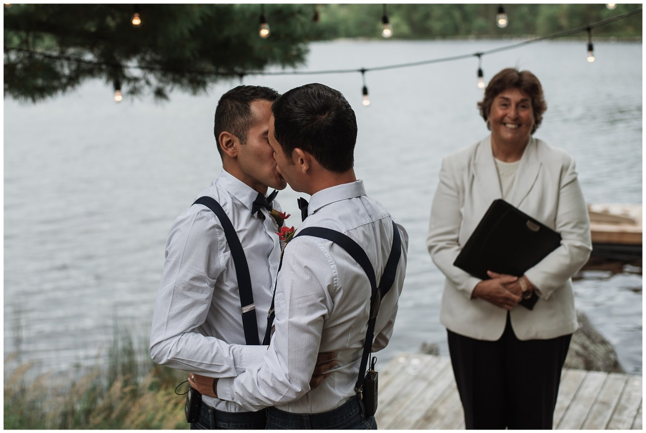 first kiss at ceremony at a backyard wedding in Porters Lake, Nova Scotia