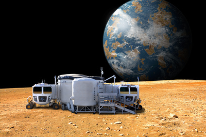 A depiction of a base on a hostile and barren moon. The moon's Earth-like planet rises in the background. The small colony is equipped with two rovers for astronauts to use for exploration of the surface. - Elements of this image furnished by NASA