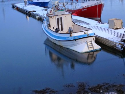 A small fishing boat frozen into the harbour at Grindavik