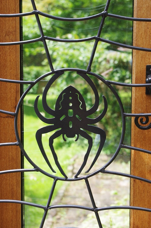 Spider web security grate