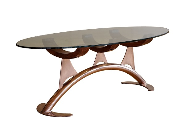 Oval glass coffee table in copper and walnut.