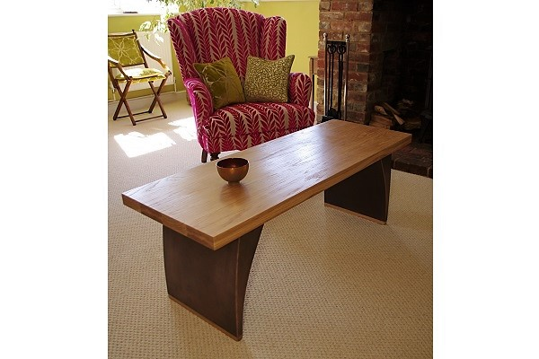 Wooden oak and bronze coffee table.