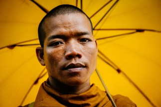 cambodian monk with umbrella