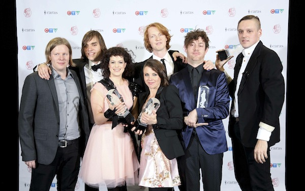 Arcade Fire pose backstage with their trophies at the 2011 Juno Awards Sunday night at the Air Canada Centre in Toronto. (CARAS)