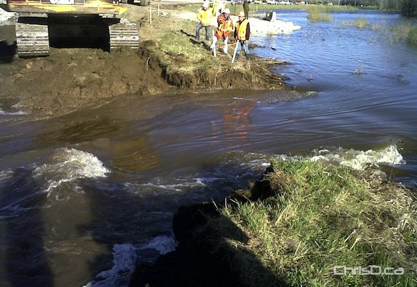 A deliberate breach was made in a dike at the Hoop and Holler Bend along Highway 331 Saturday during a controlled release. (GOVERNMENT OF MANITOBA)