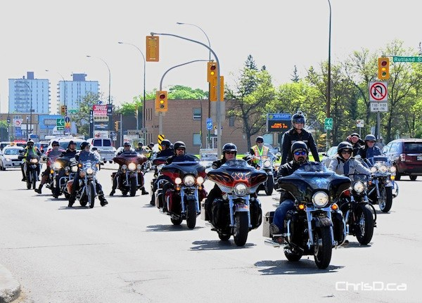 Hundreds of riders cruise up Portage Avenue on Saturday, May 28, 2011 as part of the 2011 Manitoba Motorcycle Ride for Dad. (MARC EVANS / CHRISD.CA)