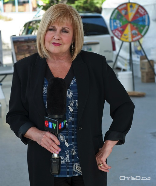 CTV weather specialist Sylvia Kuzyk delivers a live hit from The Forks on May 26, 2011. (TED GRANT / CHRISD.CA FILE)