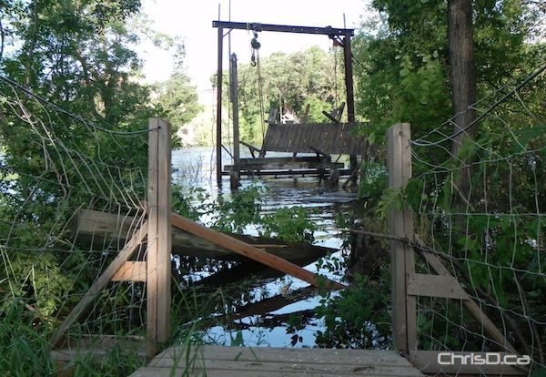 Cables to the Souris swinging bridge were cut Sunday, July 3, 2011 to protect the community's earth dike. (PROVINCE OF MANITOBA)