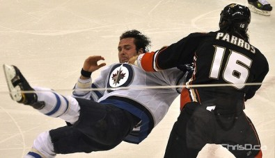Winnipeg Jets defenceman Mark Stuart (5) tussles with Anaheim Ducks forward George Parros (16) at MTS Centre on Saturday. (MAURICE BRUNEAU / CHRISD.CA)