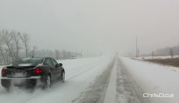 A brief snowfall Sunday afternoon made for treacherous highway conditions around Winnipeg, including on Highway 75 south of the city. (CHRISD.CA)
