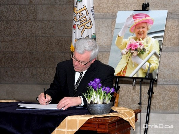 Premier Greg Selinger signs a public book of celebration at the Manitoba Legislature to honour Queen Elizabeth II's Diamond Jubilee on Monday, February 6, 2012. (STAN MILOSEVIC / MANITOBAPHOTOS.COM)