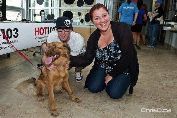 Hot 103's Ace Burpee and Chrissy Troy pose with Sasha during the IAMS 1001 Donations telethon at the Winnipeg Humane Society on Sunday, March 18, 2012. (TED GRANT / CHRISD.CA)