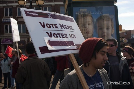 Jonathan Ventura holds a sign during the robocall protest on Sunday. (TED GRANT / CHRISD.CA)