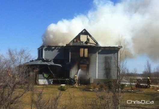Smoke billows out from a home in West St. Paul on Monday, April 16, 2012. (STAN MILOSEVIC / CHRISD.CA)