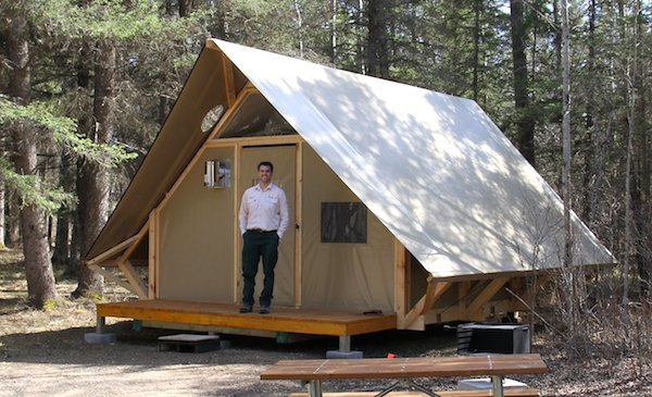Richard Dupuis, visitor experience manager, shows off the newest addition to the Wasagaming Campground: the oTENTik tents in Riding Mountain National Park. (HANDOUT)