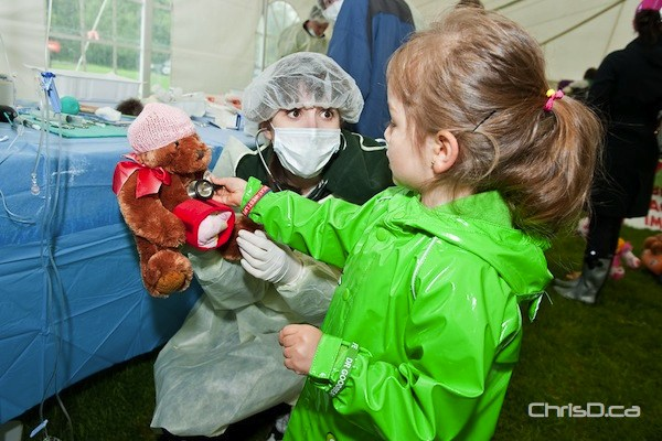 A child gets her teddy bear fixed up by a nurse in the medic tent at the Teddy Bears' Picnic on Sunday, May 27, 2012 at Assiniboine Park. (TED GRANT / CHRISD.CA FILE)