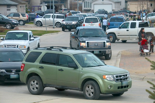 Vehicles parked illegally at garage sales and community events can cause traffic jams. The city will be warning drivers this weekend before issuing tickets following an education campaign. (CITY OF WINNIPEG)
