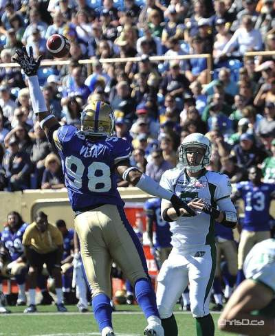 Winnipeg Blue Bombers' defensive end Jason Vega attempts to knock down a Drew Willy pass at Canad Inns Stadium on Sunday. (MAURICE BRUNEAU / CHRISD.CA)