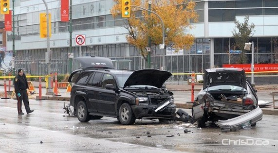 Two vehicles sit damaged on Portage Avenue at Furby Street following a crash on Monday, October 8, 2012. (STAN MILOSEVIC / CHRISD.CA)